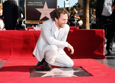 Actor Matthew McConaughey laughs while posing during a ceremony honoring him with the 2,534th star on the Hollywood Walk of Fame in Hollywood, California November 17, 2014. REUTERS/Danny Moloshok   (UNITED STATES - Tags: ENTERTAINMENT)