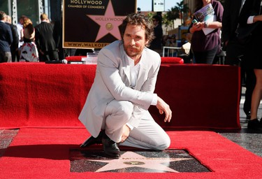 Actor Matthew McConaughey poses during a ceremony honoring him with the 2,534th star on the Hollywood Walk of Fame in Hollywood, California November 17, 2014. REUTERS/Danny Moloshok   (UNITED STATES - Tags: ENTERTAINMENT)