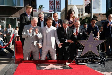Actor Matthew McConaughey reacts as his star is unveiled along with others, including guest speakers director Christopher Nolan (top L) and casting director Don Phillips (2nd top L), during a ceremony honoring him with the 2,534th star on the Hollywood Walk of Fame in Hollywood, California November 17, 2014. REUTERS/Danny Moloshok (UNITED STATES - Tags: ENTERTAINMENT)