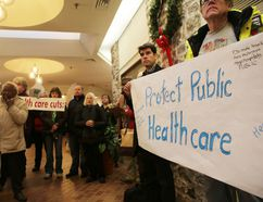 Supporters of the Kingston Health Coalition gather at a rally at the office of Kingston and the Islands MPP Sophie Kiwala on Monday afternoon. The group was protesting health care cuts by the provincial government. (Elliot Ferguson/The Whig-Standard)
