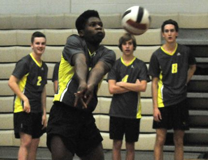 Samuel Eche-Awah, of the Charles Spencer High School Mavericks, returns the volleyball against the Grande Prairie Composite High School Tomahawks at 4A Zones on Wednesday, November 12, 2014 at Grande Prairie Composite High School in Grande Prairie, Alta. The Mavericks won the match in three sets and qualified for 4A Provincials in Lloydminster, Alta, on Nov. 20-22. LOGAN CLOW/DAILY HERALD TRIBUNE/QMI AGENCY