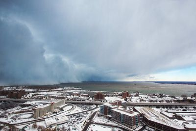 Storm clouds and snow blows off Lake Erie in Buffalo, New York, November 18, 2014.  REUTERS/Lindsay DeDario