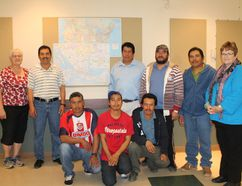 Volunteer English instructors Jeannie Baker and Barb Murray stand with seven of their students: Alejandro, Jesus, Gregorio, Juan, Horje, Ricardo and Jostino in front of a map of Mexico in the Carman United Church, where the classes took place. The teachers, and students if they return next year, are planning to continue the lessons when the migrant workers return to Carman next season. (EMILY DISTEFANO/CARMAN VALLEY LEADER)
