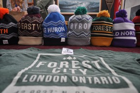 A line of neighbourhood-specific toques by local company dpms at their Western Fair Farmer's Market location Nov. 19, 2014. CHRIS MONTANINI\LONDONER\QMI AGENCY