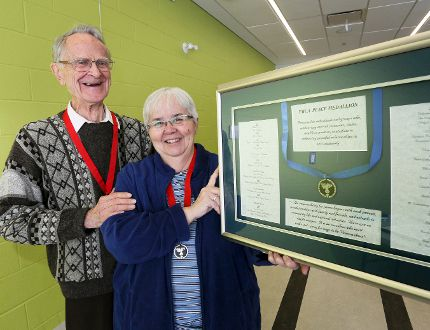 Don Wilmott, left, and Joan Beecroft with the YMCA Peace Medallion.
