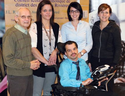 Collège Boréal announced support funding on Thursday for a physically challenged Timmins man, Christian Aubé, centre, to allow him to further his education. Those on hand for the announcement included, from left, Fern Tremblay of the Joseph Fortin Foundation, Aubé's assistant Manon Desjardins, Boréal special needs officer Angèle Labelle and École catholique St-Judes teacher Sylvie Lamarche-Lacroix.
