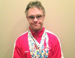 Ryan Roznowsky sports his two gold, two silver and one bronze medal earned at the 2014 Down Syndrome World Swimming Championships in Mexico. Supplied