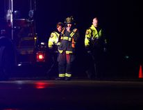 Emergency officials work at the scene of a fatal pedestrian-versus-vehicle collision on Highway 43, about 100 metres east of the intersection with Range Road 53, near Grande Prairie, Alta early in the morning on Friday, Nov. 21 2014. TOM BATEMAN/DAILY HERALD TRIBUNE/QMI AGENCY