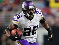 Minnesota Vikings running back Adrian Peterson carries the ball against the St. Louis Rams during their NFL game in St. Louis in this September 7, 2014 file photo. (Jeff Curry/ USA TODAY Sports)