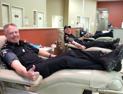 Brian Freer (left) Mike Vasey and Bubba Lyon get ready to give blood at Bayside Mall in honour of their former colleague George Klazinga. Klazinga, a comrade with the men as a member of the volunteer fire department in Wyoming, died earlier this year. BRENT BOLES / QMI Agency