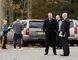 Police and investigators gather in front of the scene of a multiple shooting inside a home in Tabernacle, New Jersey, November 20, 2014. Two children were killed and two people were critically wounded in a shooting inside a home in a quiet, rural town outside Philadelphia, the state police said on Thursday. REUTERS/Tom Mihalek
