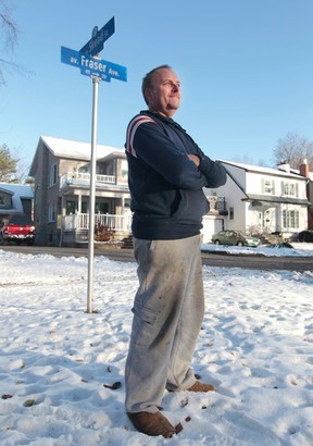 Gary Boyd poses for a photo on Fraser Street in Ottawa Friday Nov 21,  2014. Boyd is delighted with the NCC's decision to reject the city's proposal to extend LRT across federal land near his home on Fraser Ave.  Tony Caldwell/Ottawa Sun/QMI Agency