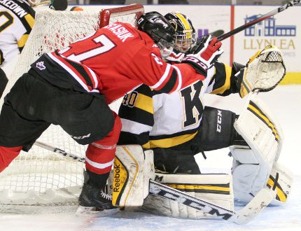 Owen Sound Attack's Zach Nastasiuk collides with Kingston Frontenacs goaltender Lucas Peressini during the first period of Friday night's Ontario Hockey League game at the Rogers K-Rock Centre.