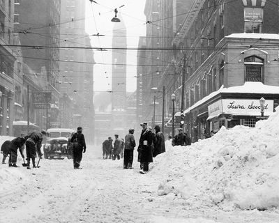 As the snow storm of December 11-12, 1944 began to subside, crews did what they could to clear the intersection of Bay and Adelaide streets in the heart of the city. The task was made worse because so many able-bodied men were away on military service.