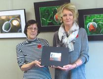 Beverly Anderson and Antoinette Blankvoort, of the North Norfolk-MacGregor Archives, at the presentation of the book Remembering our veterans on Nov. 9. (Submitted photo)