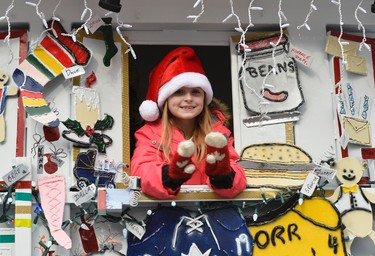 People from all over city came out to see the Help Santa Toy Parade in Ottawa on Saturday, Nov. 22, 2014. Matthew Usherwood/Ottawa Sun