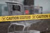 Caution tape placed by Trauma Scene Bio Services personnel is seen in front of a Dollarama store at Manning Town Centre at 153 Avenue and 37 Street in Edmonton, Alta., on Saturday, Nov. 22, 2014. A shooting occurred near the store on Friday night. Ian Kucerak/Edmonton Sun/ QMI Agency