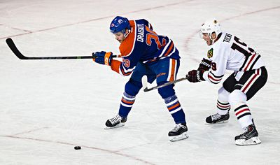 Edmonton's Leon Draisaitl (29) is chased by Chicago's Jonathan Toews (19) during the second period of the Edmonton Oilers' NHL hockey game against the Chicago Blackhawks at Rexall Place in Edmonton, Alta., on Saturday, Nov. 22, 2014. Codie McLachlan/Edmonton Sun/QMI Agency