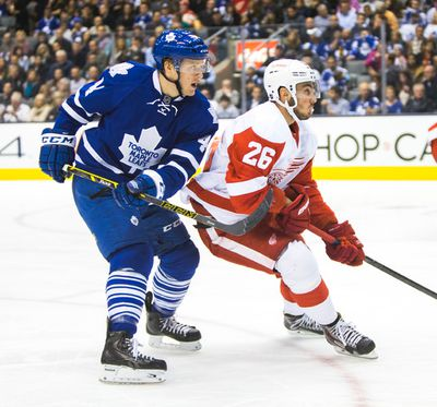 Toronto Maple Leafs  Morgan Reilly and Detroit Red Wings Tomas Jurco during 2nd period action at the Air Canada Centre in Toronto on Saturday November 22, 2014. Ernest Doroszuk/Toronto Sun/QMI Agency
