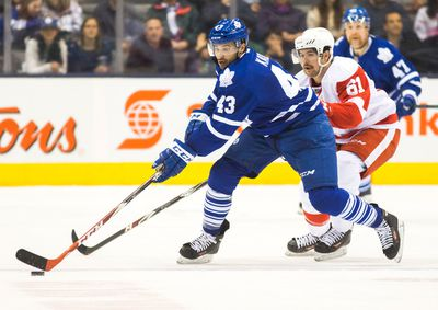 Toronto Maple Leafs Nazem Kadri and Detroit Red Wings  Xavier Ouellet during 2nd period action at the Air Canada Centre in Toronto on Saturday November 22, 2014. Ernest Doroszuk/Toronto Sun/QMI Agency