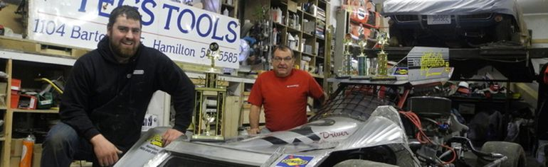 Bob Mercer (left) and his father Ken Mercer have built an open-wheel modified racing car, which they race at Flamboro Speedway. (Michael-Allan Marion / Expositor Staff)