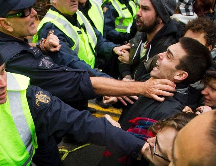 Protesters clash with police at the Kinder Morgan survey area on Burnaby Mountain. Reuters