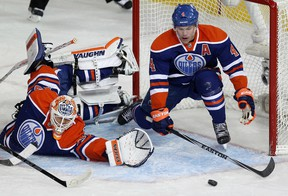 Taylor Hall and goalie Ben Scrivens face another barrage of opposition shots (David Bloom, Edmonton Sun).