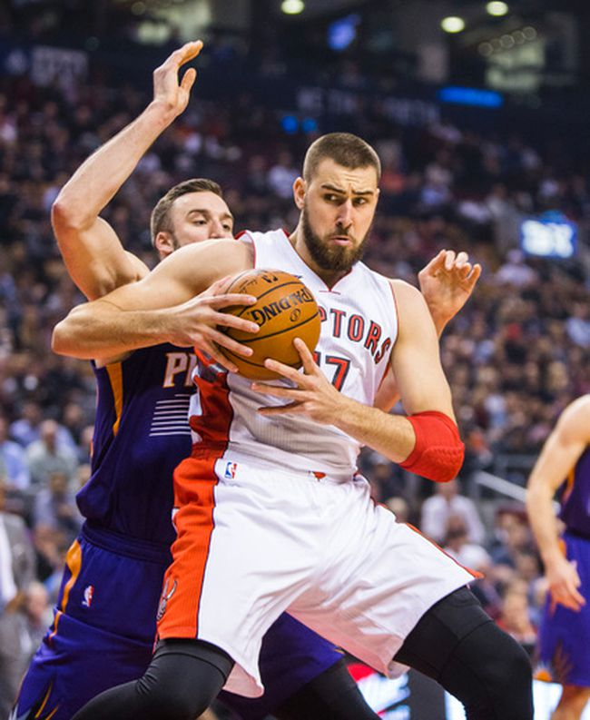 Raptors' Jonas Valanciunas battles the Suns' Miles Plumlee during first-half action at the Air Canada Centre on Monday night. (Ernest Doroszuk/Toronto Sun)