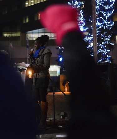 Local community leader Nyabuoy Gatbel speaks to the crowd at the Black Lives Matter protest at City Hall in Calgary, Alta on Tuesday Nov 25, 2014. The protest follows the no indictment decision of Ferguson, Missouri police officer Darren Wilson after he shot Mike Brown this summer. Gavin John/STR/Calgary Sun