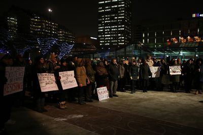 Protestors gather at Winston Churchill Square in downtown Edmonton on Tuesday, November 25, 2014 speaking out against the killing of Ferguson, Mo teenager, Michael Brown. TREVOR ROBB/EDMONTON SUN/QMI AGENCY
