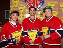 Dallas Graham, Andrew Juba and Eric Paterson of the Wetaskiwin Icemen stand with Slices of Hope at Boston Pizza Nov. 20 for the Sign of Hope fundraiser. AMIELLE CHRISTOPHERSON/WETASKIWIN TIMES/QMI AGENCY