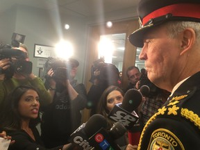 Chief Bill Blair speaks to reporters on Wednesday following the arrest of Jian Ghomeshi. (DON PEAT/Toronto Sun)