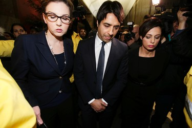 Jian Ghomeshi leaves College Park Court with lawyer Marie Henein, right, after being freed on bail on Wednesday, November 26, 2014. (Craig Robertson/Toronto Sun)