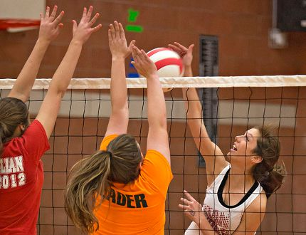 <p>Avery Hamill spikes the ball while team mates Natalee Farmer (left) and Faye Perry go up for the block during a Paris Panthers senior girls volleyball practice on Wednesday, November 26, 2014 at Paris District High School.</p><p>Brian Thompson/Brantford Expositor/QMI Agency