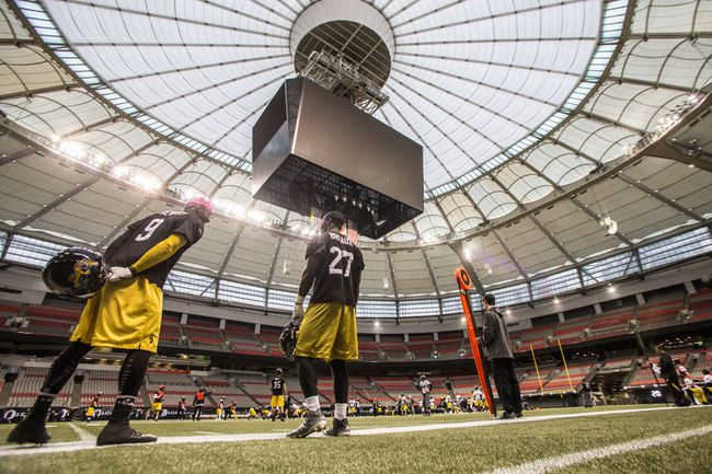Hamilton Tiger Cats Brandon Stewart (left) and Delvin Breaux (right) during the team practice at the CFL's 102nd Grey Cup Festival in Vancouver, B.C. on Wednesday. Photo by Carmine Marinelli/QMI Agency.
