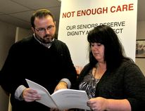 Kevin Tyrell, regional vice president for the Ontario Council of Hospital Unions, and public support worker representative Dorothy Winterburn look over a report presented at the Brockville Legion Wednesday about the failings in long-term care in Ontario (NICK GARDINER/The Recorder and Times).