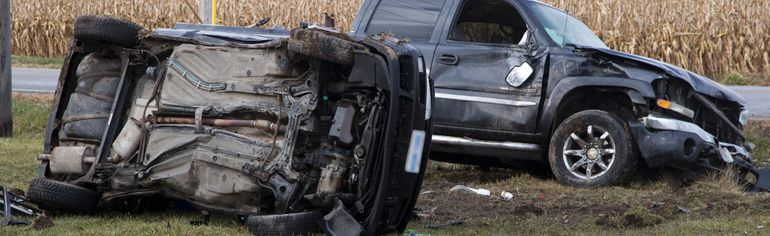 The driver of the car was airlifted to hospital with life threatening injuries after colliding with the pick-up truck at the intersection of Coldstream Road and Oxbow Drive in Komoka, Ontario on Thursday, November 27, 2014. The diver of the truck was not seriously injured. The license plates have been obscured at the request of police. (DEREK RUTTAN, The London Free Press)