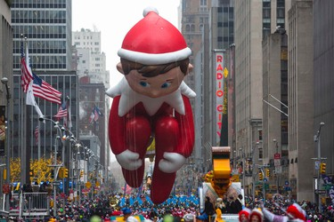 The Elf on the Shelf balloon floats down Sixth Avenue during the 88th Annual Macy's Thanksgiving Day Parade in New York November 27, 2014. REUTERS/Andrew Kelly