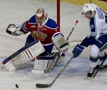 Edmonton Oil Kings goalie Patrick Dea makes a save as Swift Current Broncos Coda Gordon  moves in for the rebound during first period action at Rexall Place in Edmonton Alta.,  on Wednesday Nov 26, 2014. Tom Braid/Edmonton Sun/QMI Agency