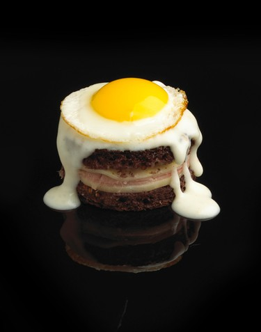Croque MadameBechamel Sauce:INGREDIENTS:- 5 Tbsp. (75 ml) unsalted butter- 1 Tbsp. (15 ml) flour- 1 cup (250 ml) milk- 1/4 tsp. (1 ml) kosher salt- 1/4 tsp. (1 ml) ground black pepper- Pinch ground nutmeg- 1 cup (250 ml) grated Gruyere cheeseDIRECTIONS:In small saucepan melt 2 Tbsp. (30 ml) butter over high heat. Whisk in flour and cook until lightly golden. Add cold milk and salt and whisk constantly until mixture thickens – about 2 minutes. Remove from heat and stir nutmeg and half cheese into the milk mixture. Set aside.INGREDIENTS:- 6 thin slices pumpernickel- 1 Tbsp. (15 ml) Dijon mustard- 3 pieces thinly sliced black forest ham- 12 quail eggs- Ground black pepperDIRECTIONS:Preheat oven broiler. Lay out bread slices and spread Dijon evenly between three slices and top with ham. Divide half of bechamel between remaining 3 bread slices and top with remaining cheese. Close sandwiches. Melt 2 Tbsp. (30 ml) butter in a non-stick pan over medium heat. Add sandwiches and cook both sides until bread is golden brown and cheese is melted, about 3-4 minutes. Cut 4 small sandwiches out of each larger one using a round cookie cutter and place on baking sheet. Top each with remaining bechamel, and place under broiler until bubbly.Meanwhile, melt remaining butter in the same skillet over high heat - fry quail eggs, sunny side up, about 1 minute. Top sandwiches with fried egg, season with black pepper, and serve immediately.