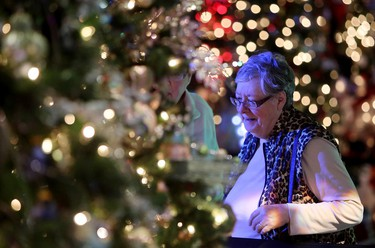 Visitors to the 30th annual Festival of Trees look at the Christmas trees on display at the Shaw Conference Centre, in Edmonton Alta., on Thursday Nov. 27, 2014. The Festival of Trees runs from Nov. 27 to 30. David Bloom/Edmonton Sun/QMI Agency
