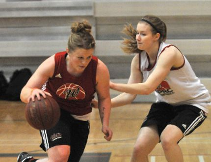 Sydney Litwin, left, of the Grande Prairie Regional College Wolves women's basketball team, drives around a teammate during a scrimmage on Wednesday. Logan Clow/Daily Herald-Tribune
