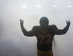 Hamilton Tiger-Cats Bryan Hall takes the field before his team plays the Edmonton Eskimos during the first half of their CFL football in Hamilton, September 20, 2014. (REUTERS/Mark Blinch)