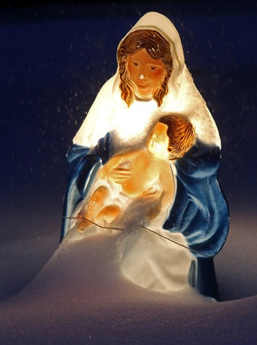 A virgin Mary and baby Jesus Christmas decoration looks a little frosty as it sits in a front yard on 159 St., near 81 Ave., in Edmonton Alta., on Thursday Nov 27, 2014. Tom Braid/Edmonton Sun/QMI Agency