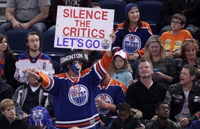 Oilers fan Blair Madoo Gladue holds up a sign during third period NHL action between the Oilers and Devils in Edmonton on Nov. 20, 2014. (David Bloom/QMI Agency)