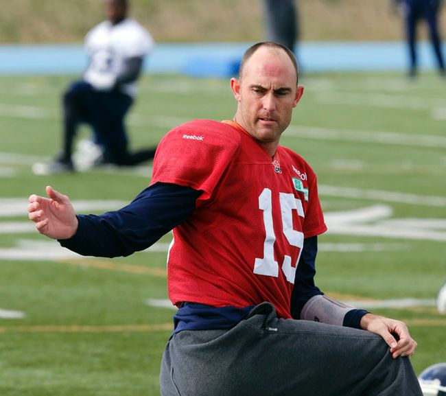 QB Ricky Ray stretches the team out while sipping on a coffee in the cool air as the Toronto Argonauts prepare for their CFL game in Montreal  On Sunday during CFL action in Toronto, Ont. on Thursday October 30, 2014. (Michael Peake/QMI Agency)