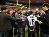 Hamilton Tiger Cats Brandon Banks is surrounded by reporters after their team's practice at the CFL's 102nd Grey Cup week in Vancouver, British Columbia, November 26, 2014. (REUTERS/Todd Korol)
