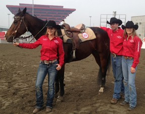 Carly Hurrel of London, left, and Krista McNea of West Lorne, right, stand with coach Chris Blane and a Canadian horse that helped them win the recent Shanghai Barrel Racing World Cup. Hurrel and McNea represented Canada in the competition, defeating defending champion Brazil in the final.