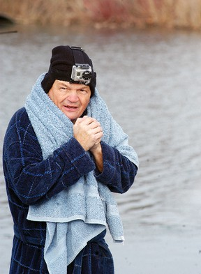 Wallaceburg United Way campaign chair Newt Richardson tries to keep warm before he goes into the water on Nov. 28, during the United Way's third annual Freezin' for a Reason polar bear dip held at MacDonald Park. The event was a fundraiser for the local United Way campaign.