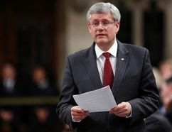 Prime Minister Stephen Harper speaks during Question Period in the House of Commons on Parliament Hill in Ottawa November 25, 2014. REUTERS/Chris Wattie
